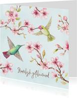 Verjaardagskaart met kersenbloesem en kolibri's