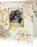 Jubileumkaart bloemen goud met waterverf foto en spetters