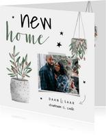 Kerst verhuiskaart met foto, planten en sterren