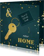 Kerst-verhuiskaart sleutel met label new home