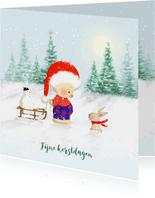Kerstbeer met slee en konijn in de sneeuw