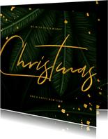 Kerstkaart jungle bladeren met gouden 'christmas'