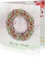 Kerstkaart kerstkrans met sleutel en kerstgroen