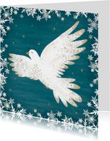 Kerstkaart met een vredesduif, turquoise achtergrond.