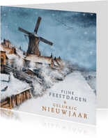 Kerstkaart met Hollands winterlandschap en molen in sneeuw