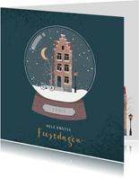 Kerstkaart met illustratie van een sneeuwbol met huisje