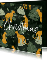 Kerstkaart met jungle patroon en handgeschreven christmas