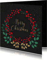 Kerstkaart met rode besjes en goudlook takjes