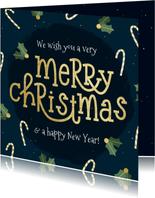Kerstkaart typografisch met zuurstok en hulst goudlook