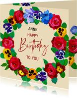 Kleurige kaart met bloemen voor een jarige vrouw