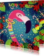 Kleurrijke kerstkaart met flamingo en bloemen