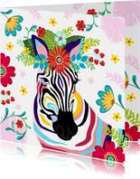 Kleurrijke zebra met bloementooi verjaardagskaart.