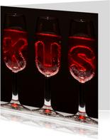 KUS in champagne glazen
