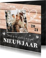 Nieuwjaarskaart hout krijtbord hartjes lampjes foto