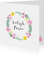 Paaskaart met cirkel van bloemen en blaadjes