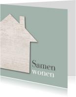 Samenwonen houten huis groen