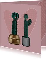 Schattige valentijnskaart verliefde cactussen en groot hart