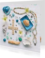 Spreukenkaart zeewind met letters schelpen en edelstenen