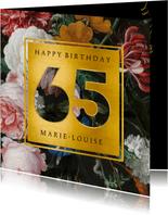 Stijlvolle verjaardagskaart met bloemen en leeftijd 65