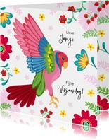 Stijlvolle verjaardagskaart papegaai met bloemen en planten