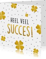 Succes kaart met gouden klavertjes vier