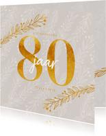 Uitnodiging 80 jaar in goud look en siertakjes