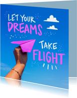 Veel geluk kaart met een papieren vliegtuigje