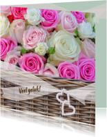 Veel geluk met mand rozen