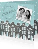 Verhuiskaart kerst huisjes sneeuw foto
