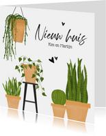 Verhuiskaart met groene planten nieuw huis