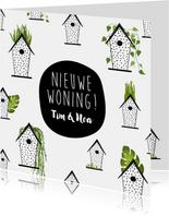 Verhuiskaart met vogelhuisjes en groene planten