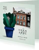 Verhuiskaartje 'nieuwe woning' met plant en kat