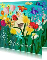Verjaardag - winterkoninkje tussen de bloemen