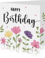 Verjaardagskaart met bloemen en hartjes