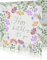 Verjaardagskaart met kleurrijke bloemenrand