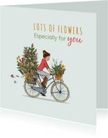 Verjaardagskaart op de fiets met veel bloemen
