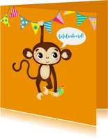 Verjaardagskaart vrolijk aapje met banaan en slingers