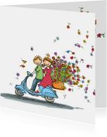 Vespa scooter met bloemen