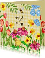 Vrolijk Pasen narcissen en tulpen bloemen.