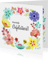 Vrolijke en kleurrijke verjaardagskaart met bloemenkrans