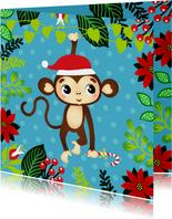 Vrolijke kerstkaart met aapje in de jungle