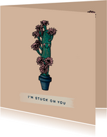 Vrolijke liefde kaart met verliefde cactus vol roze bloemen