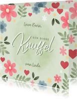 Vrolijke zomaar kaart met bloemen en 'Knuffel'