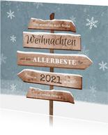 Weihnachtskarte Wegweiser und Schneeflocken