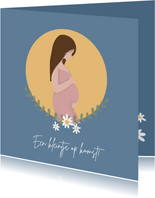 Zwangere vrouw met maan en bloemen