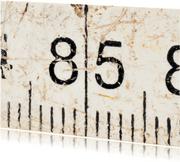 85 op oude witte duimstok