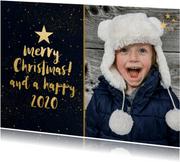 Gouden sterren kerstkaart met zwarte achtergrond