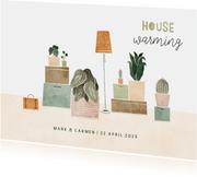 Housewarming uitnodiging met plantjes en verhuisdozen