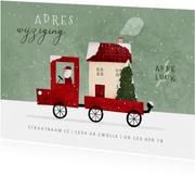 Kerst-verhuiskaartje verhuisbusje met huis en kerstboom