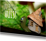 Slakje met nieuw huis verhuiskaart